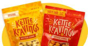 Two bags of Kettle Kravings kettle corn with yellow backdrop